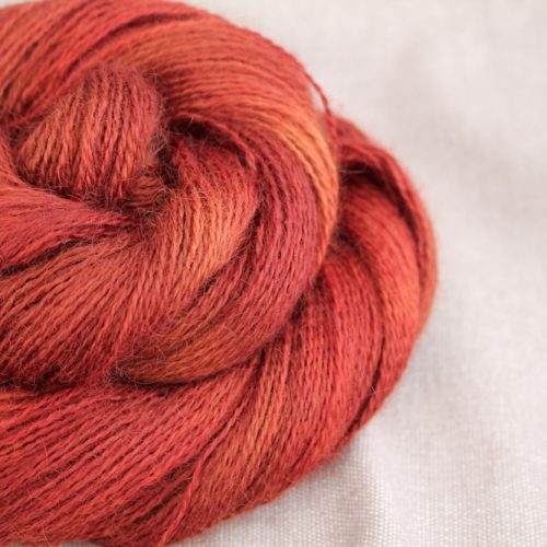 A skein of Aysgarth 4 Ply in the Roast Chestnut colourway