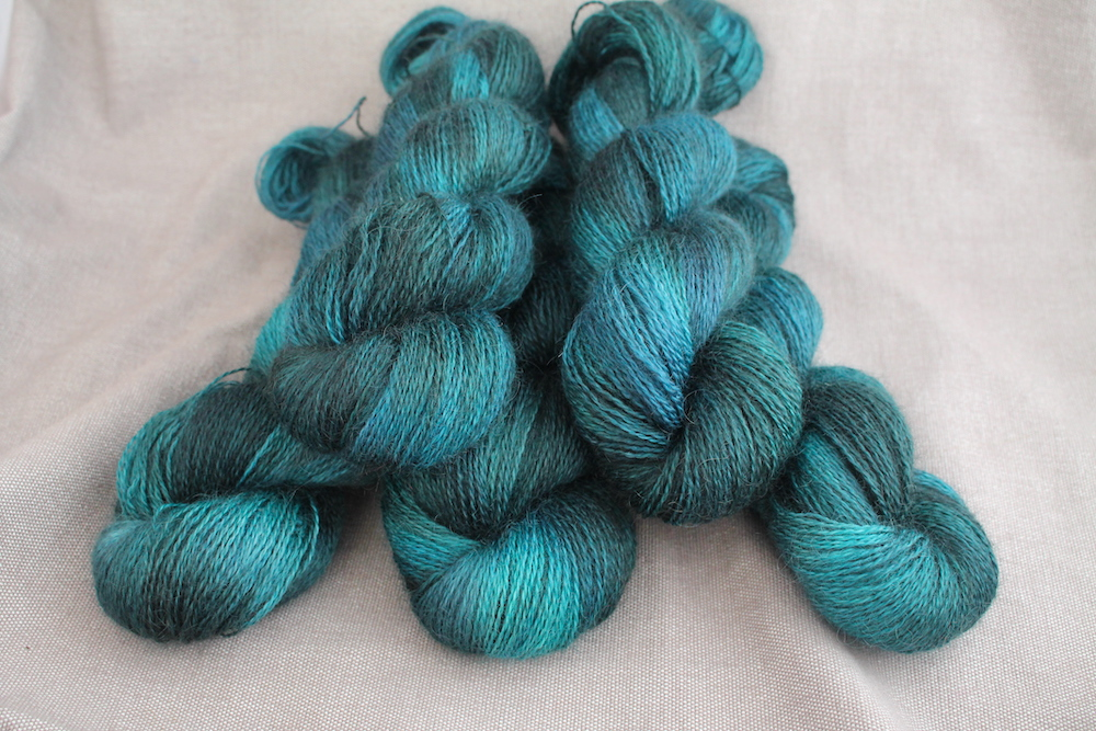 A pile of skeins of Aysgarth in the Gathering colourway