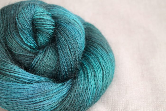 A skein of Aysgarth 4 Ply in the Gathering colourway