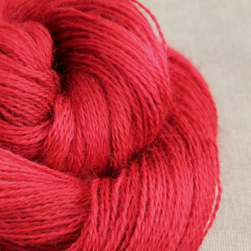 A skein of Aysgarth 4 Ply in the Rosehip colourway