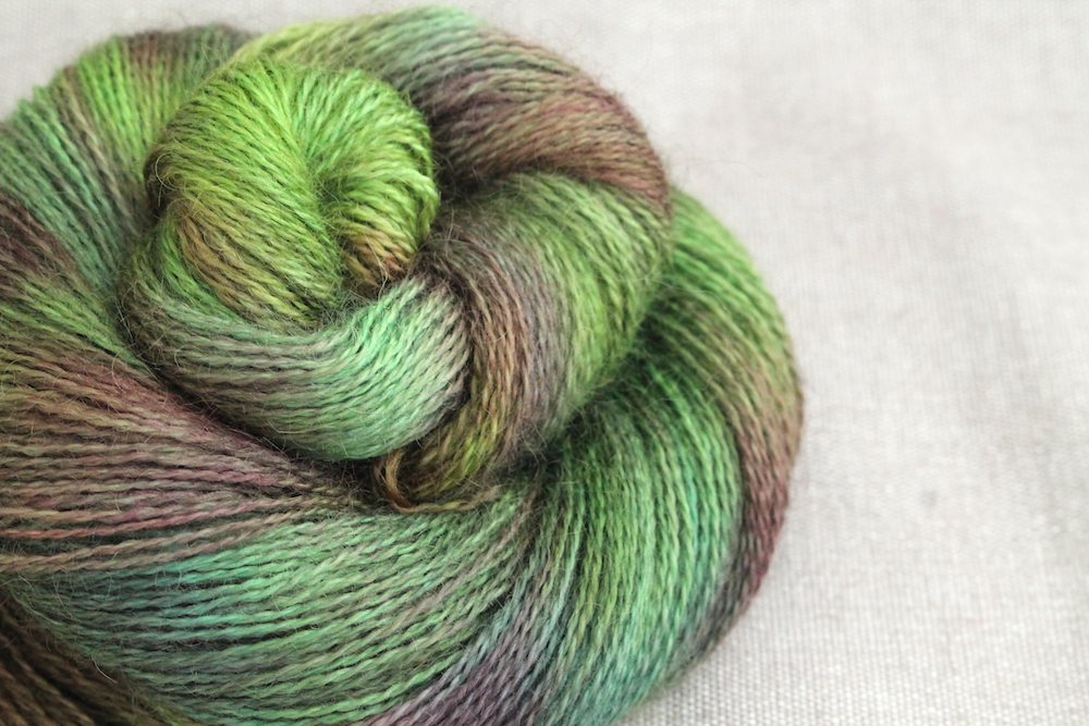 A skein of Aysgarth 4 Ply in the Bramble colourway