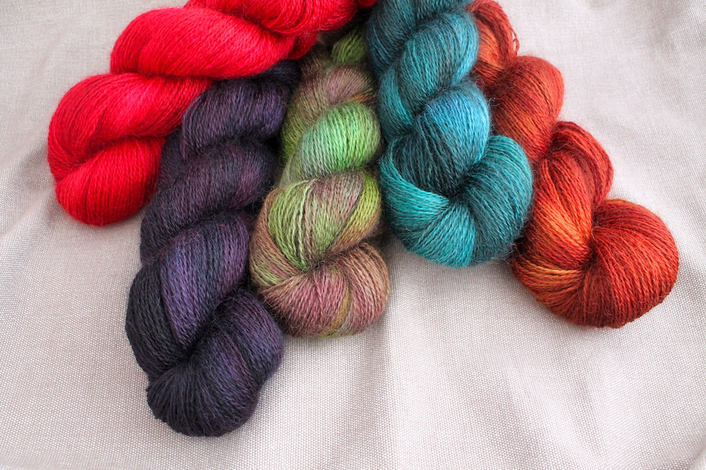 A pile of Aysgarth skeins in various colourway