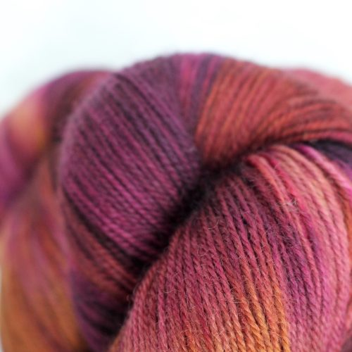 Skeins of the Nectarine colourway - warm and rich purples, reds and browns