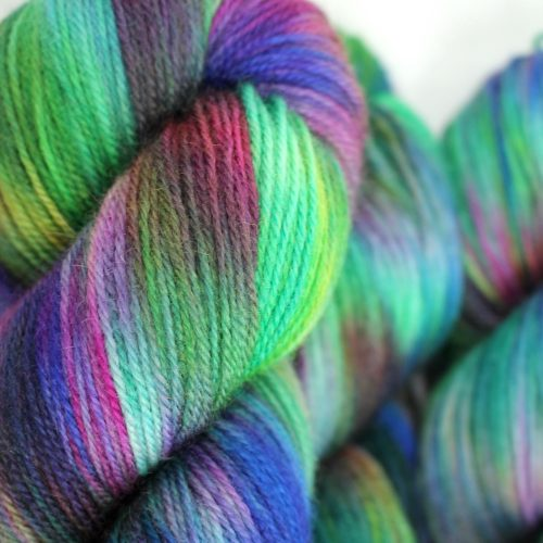 Skeins of Mermaid, a rainbowy highly variegated colourway