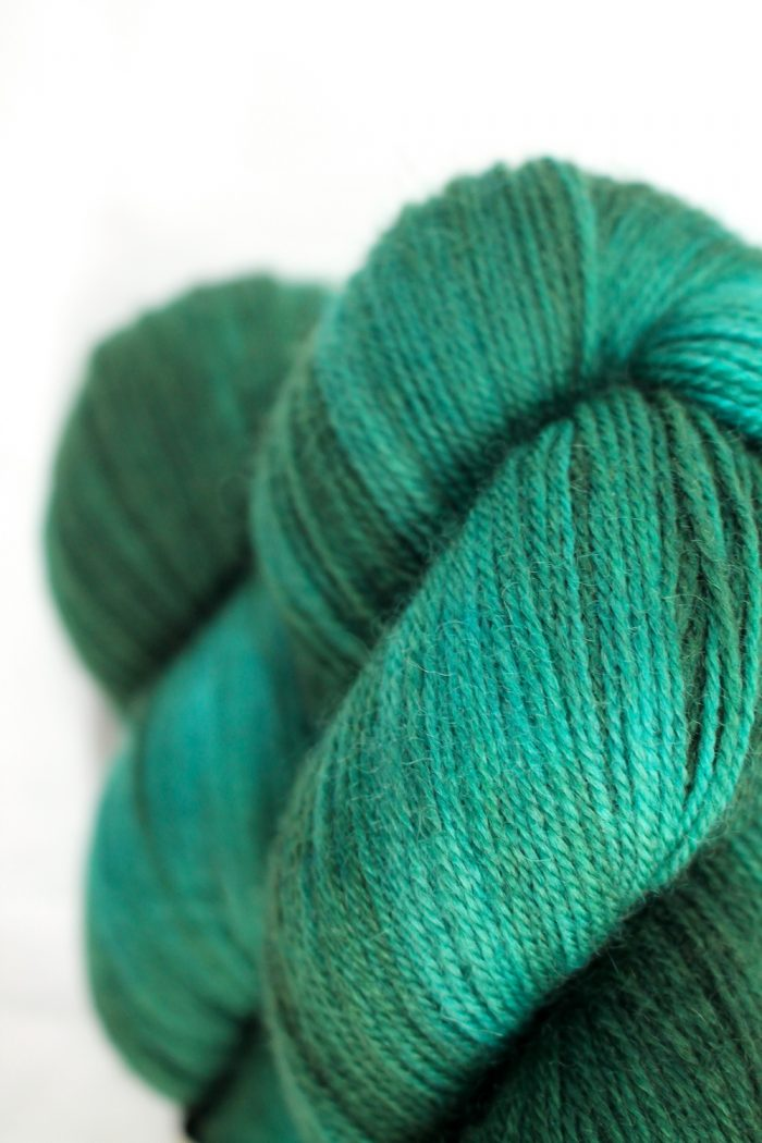 Skeins of First Footing, a festive pine green and jade colourway
