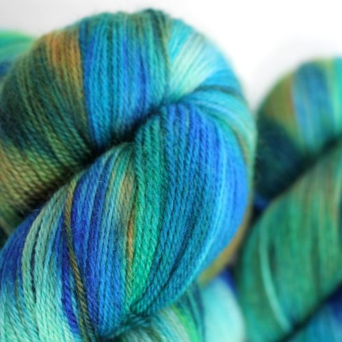 Skeins of Kingfisher in colours reminiscent of the bird: blue, turquoise and orange.