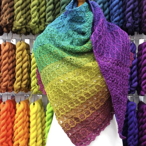 A rainbow shawl on a mannequin