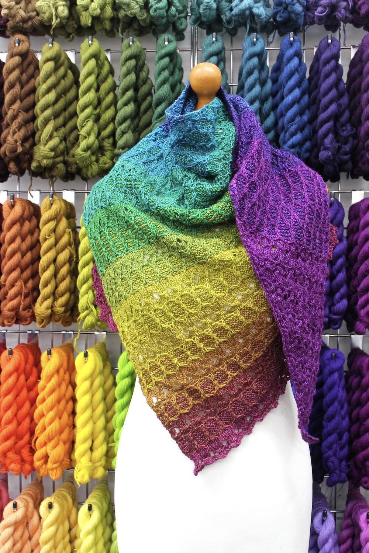 A rainbow shawl on a mannequin