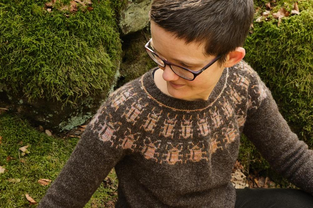 Close up of Katie wearing the Beetle Magic jumper