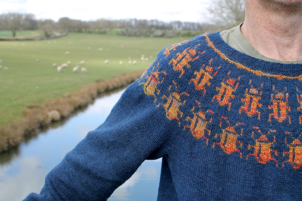 Close up of Markus wearing the Beetle Magic jumper