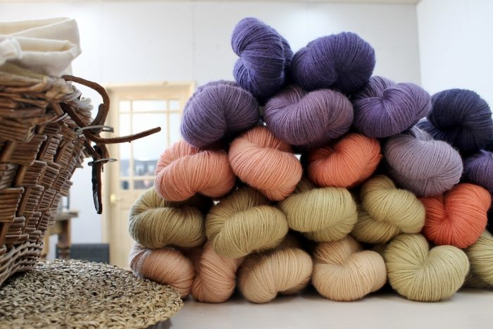 A pile of naturally dyed skeins on Nene 4 Ply