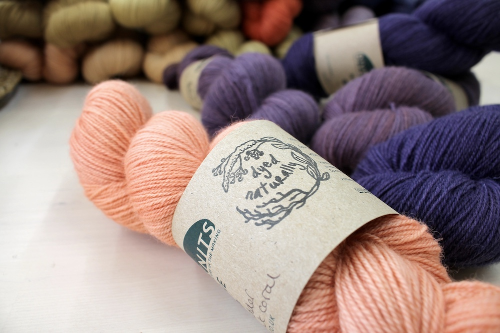 A close up of a naturally dyed skein of Nene 4 Ply