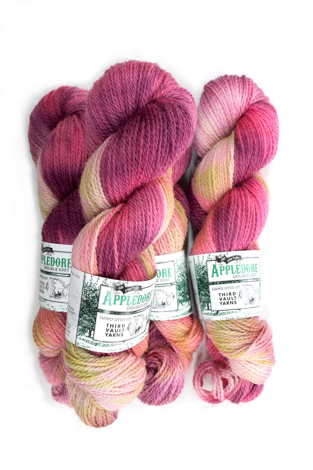 Skeins of Appledore in the Dragon Fruit colourway