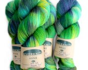 Skeins of Nene 4 Ply in zesty greens with pops of yellow and purple
