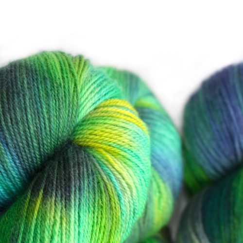 Close up of skeins in zesty green with pops of yellow and purple