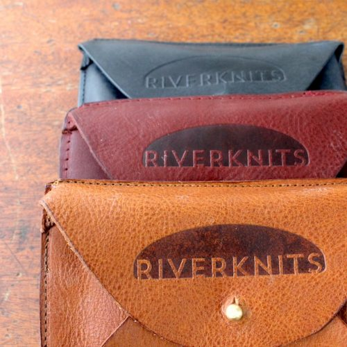 3 leather crafter's wallets in tan, burgundy, and navy